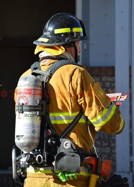 A firefighter with Haz Mat Truck 14 doing accountability on the scene of a house fire. March 21, 2015
