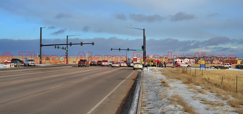 Emergency vehicles on the scene of a traffic accident, with one party trapped, at the intersection of Constitution Avenue and Marksheffel Road, in El Paso County, Colorado.