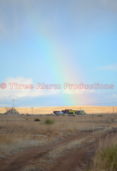 A rainbow appears over the scene of a wildland fire in Ellicott, Colorado. April 9, 2016