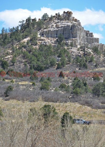 Colorado Springs Police Officers closed off Pulpit Rock Park, while firefighters extinguish a wildland fire.