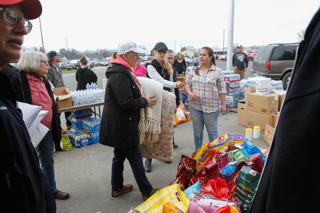 . Volunteers help sort and distribute water, dog food, blankets and other good to about 700 people who were displaced when an emergency evacuation was called on the town of Oroville and surrounding at the emergency evacuation center Monday February 13, 2017 at the Silver Dollar Fairgrounds in Chico, California. (Emily Bertolino - Enterprise-Record)