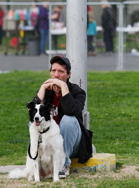 . Tim Copeland of Oroville sits with his dog Oreo as he and over 16,000 others were evacuated from the town of Oroville February 13, 2017 at the Silver Dollar Fairgrounds in Chico, California.  About 700 people currently occupy the shelter as an emergency evacuation was called Sunday evening on the town of Oroville and surrounding areas displaying over 180,000 people. (Emily Bertolino -- Enterprise-Record)