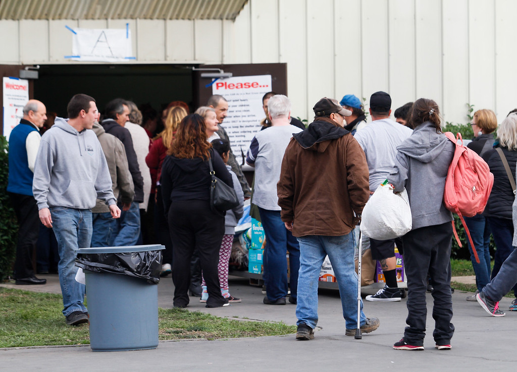 . People enter and exit an emergency shelter February 13, 2017 at the Silver Dollar Fairgrounds in Chico, California. About 700 people who were displaced when an emergency evacuation was called on the town of Oroville and surrounding at the emergency evacuation center. (Emily Bertolino -- Enterprise-Record)