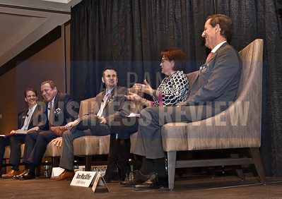 Senior reporter Michael DeMasi, left, with panelists Tom Burke, principal of Burke Cos.; Daniel Fariello, market executive & commercial team leader at Capital Bank; Ann MacAffer, associate broker at CBRE-Albany and Rich Rosetti, president of Rosetti Development Cos.