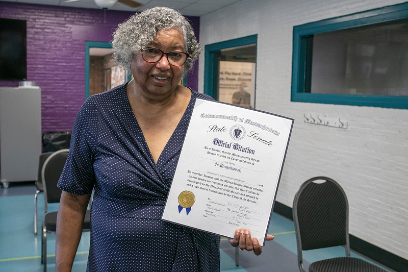 Emily MacRae executive director of North Central Faith Based Community Coalition with her citation from from State Senator John Cronin during a celebration honoring her as a Commonwealth heroine for her work in feeding those in need in Fitchburg. SENTINEL & ENTERPRISE/JOHN LOVE