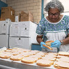 Emily MacRae executive director of North Central Faith Based Community Coalition makes some sandwiches for the many they help feed out of the YMCA in Fitchburg on Wednesday night SENTINEL & ENTERPRISE/JOHN LOVE
