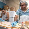 Emily MacRae executive director of North Central Faith Based Community Coalition works with Assistant Food Manager Louie Martinez as they get food ready for the many they help feed out of the YMCA in Fitchburg on Wednesday night SENTINEL & ENTERPRISE/JOHN LOVE