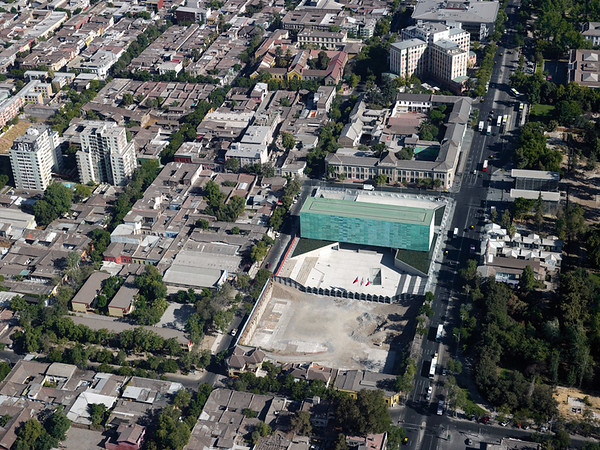 """Architectural Rendering - Aerial view features Museo de la Memoria y Los Derechos Humanos (Museum of Memory and Human Rights) and Plaza de la Memoria (Plaza of Memory) – Located in Barrio Yungay, Santiago de Chile.  The museum's website states, """"since 1839, Barrio Yungay has harbored artists and intellectuals, theatres, schools, churches, and museums, and is part of a cultural circuit that articulates interesting institutions from the area.""""  (Translation by Lissette Olivares)"""