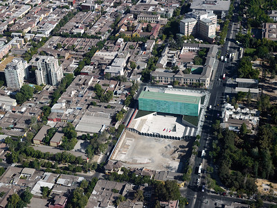 "Architectural Rendering - Aerial view features Museo de la Memoria y Los Derechos Humanos (Museum of Memory and Human Rights) and Plaza de la Memoria (Plaza of Memory) – Located in Barrio Yungay, Santiago de Chile.  The museum's website states, ""since 1839, Barrio Yungay has harbored artists and intellectuals, theatres, schools, churches, and museums, and is part of a cultural circuit that articulates interesting institutions from the area.""  (Translation by Lissette Olivares)"