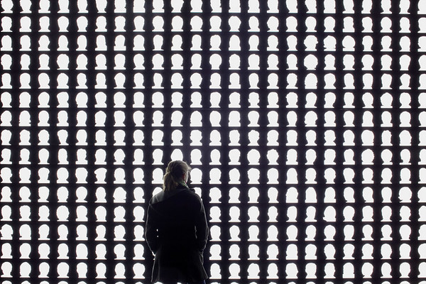 Confronted with a wall of illuminated silhouette profiles. (Courtesy Alfredo Jaar Studio)