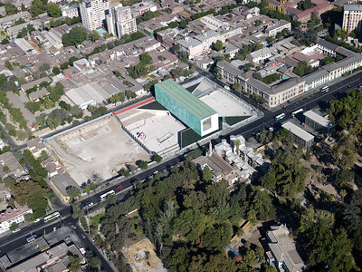 "Architectural Rendering - Aerial view features Museo de la Memoria y Los Derechos Humanos (Museum of Memory and Human Rights) and Plaza de la Memoria (Plaza of Memory) – Located in Barrio Yungay, Santiago de Chile.  The museum's website states, ""since 1839, Barrio Yungay has harbored artists and intellectuals, theatres, schools, churches, and museums, and is part of a cultural circuit that articulates interesting institutions from the area.""  (Courtesy Alfredo Jaar Studio, Translation by Lissette Olivares)"