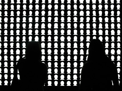 The viewers themselves become dark silhouettes within the memorial's chamber. (Courtesy Alfredo Jaar Studio)
