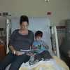 All ready to leave<br /> One last story with Mommy in her hospital bed