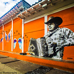 Accordion  Player & Angels' Wings: The Murals of Guelaguetza Restaurant