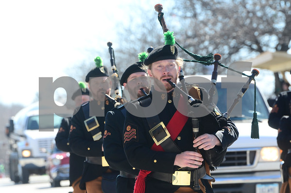 -Messenger photo by Jesse Major<br /> <br /> Patrick McCormick, of St. Paul, Minnesota, plays bag pipes with the Brian Boru Irish Pipe Band at the St. Patrick's Day parade in Emmetsburg Satruday.
