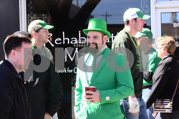 -Messenger photo by Jesse Major<br /> <br /> Brady Brady, of Emmetsburg, wears a green suit, tie and top hat at the annual St. Patrick's Day parade through Emmetsburg Saturday.