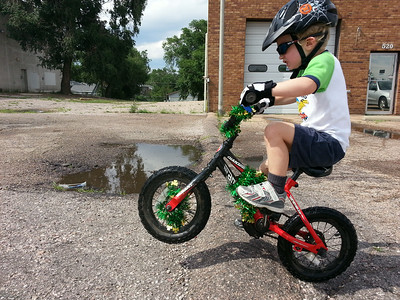 Emmett's first day of wheelies at age three point eight.  Photo credit: Alison Dunlap (Mom)