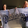 Teachers from Meadow Creek Elementary hold banner.