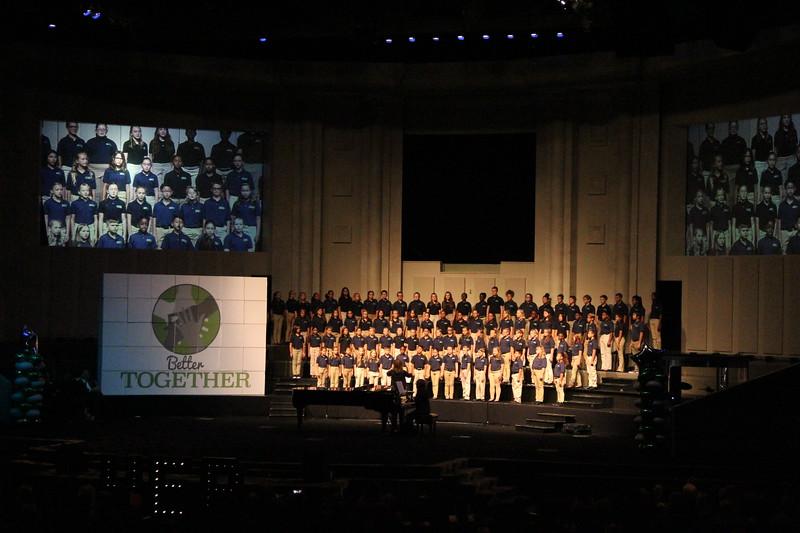 Elementary school honor choir sings.