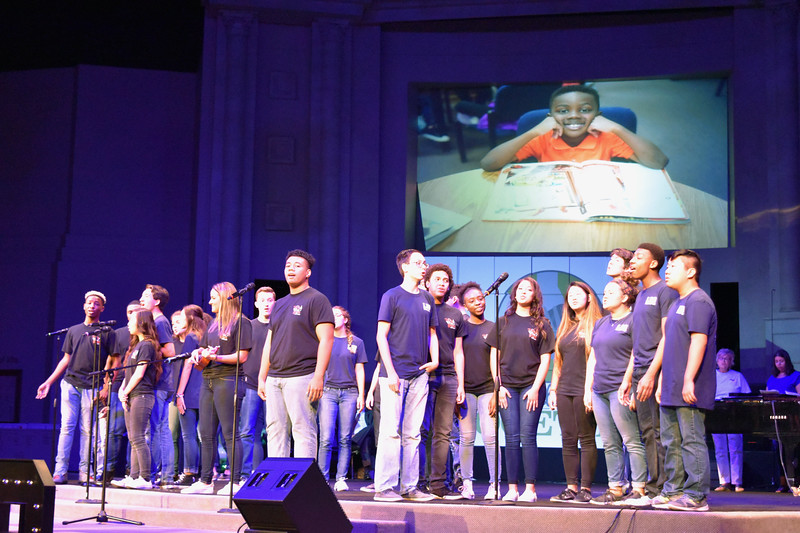 High school choir students perform a song.