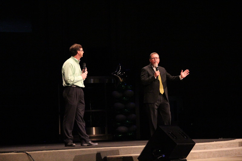 High school principals Mike Harris and Jeff Bannister perform a skit.