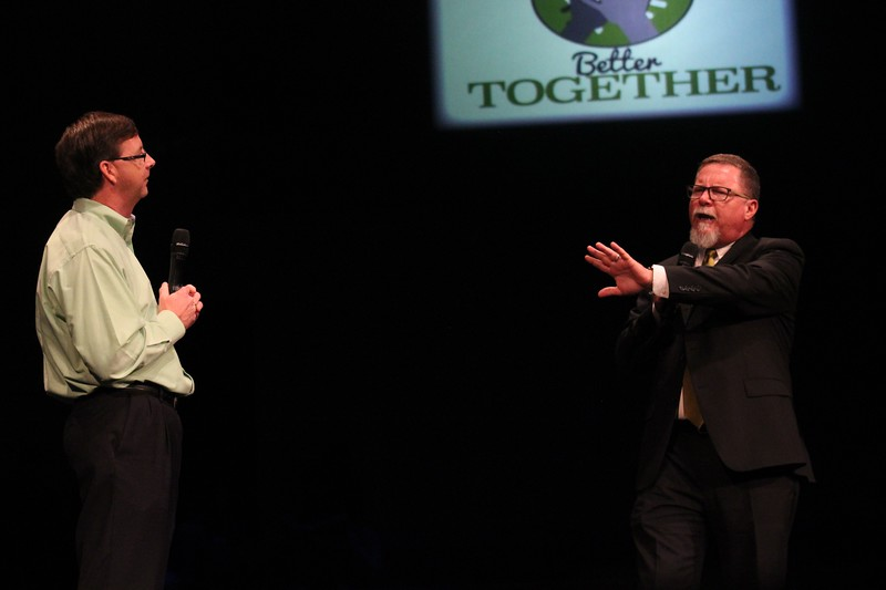 High school principals Mike Harris and Jim Bannister perform a brief skit.