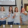 Administrators play game with buzzers.