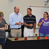 Administrators play a game using buzzers.