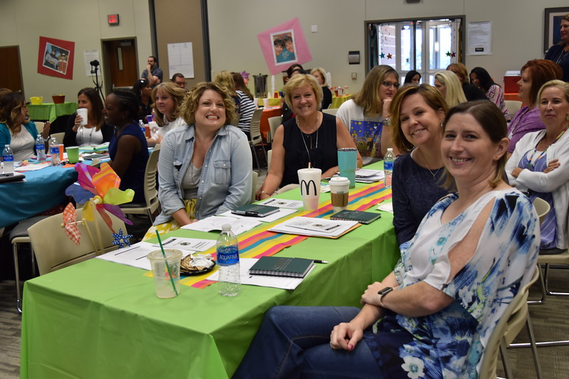 Group of elementary administrators at table..