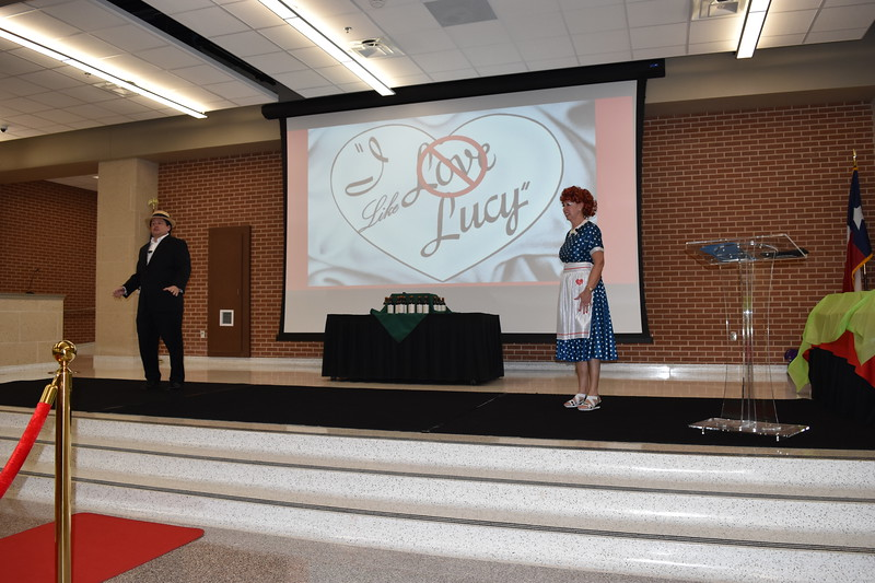 "District administrators perform a skit with backdrop that reads ""I Like Lucy""."