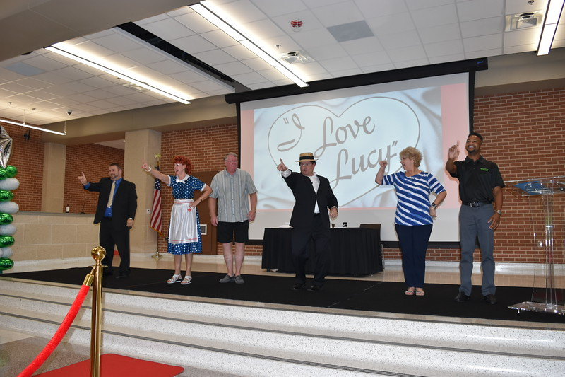 District administrators perform a skit.