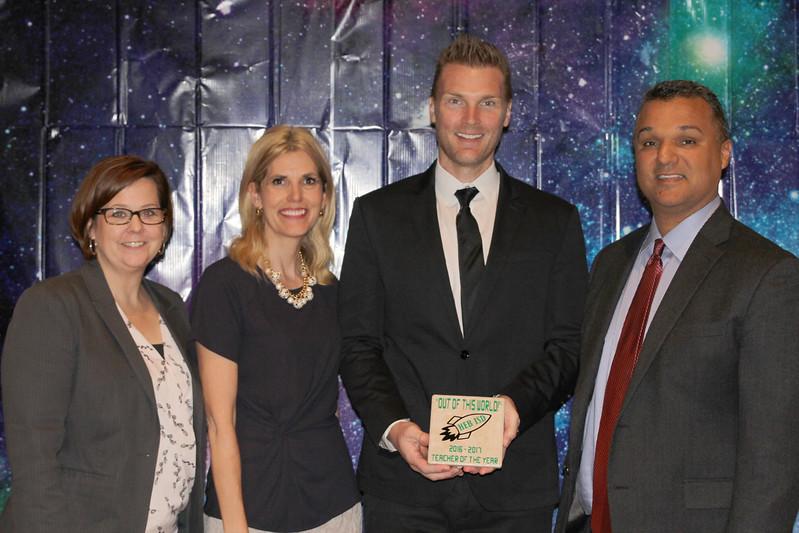 Harwood Junior High Teacher of the Year Justin Earnhart with school principals