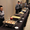 Culinary Arts students standing behind buffet serving tables