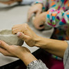 Guests work on a ceramic bowls during the Empty Bowls event at the Applewild School on Thursday evening. In conjunction with the United Neighbors of Fitchburg, the school is striving to craft up to 1,000 clay bowls. SENTINEL & ENTERPRISE / Ashley Green