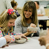 Lauren and Colleen Bagley work on a ceramic bowls during the Empty Bowls event at the Applewild School on Thursday evening. In conjunction with the United Neighbors of Fitchburg, the school is striving to craft up to 1,000 clay bowls. SENTINEL & ENTERPRISE / Ashley Green