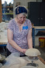 Barb McCrae shapes a bowl over a form.<br /> DAVID LACHANCE - BENNINGTON BANNER