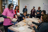 Cindy Hudson-Knapp demonstrates how to shape a bowl over a form as Yoko Inoue, a member of Bennington College's art faculty, looks on. Inoue and students in her Social Kitchen: Ceramics, Food and Community class are working with Greater Bennington Interfaith Community Services on the Empty Bowls project.<br /> DAVID LACHANCE - BENNINGTON BANNER