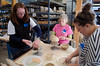 From left, Jessica Massey, Melissa Leland and Hannah Foster work on their bowls for the Empty Bowls soup supper.<br /> DAVID LACHANCE - BENNINGTON BANNER