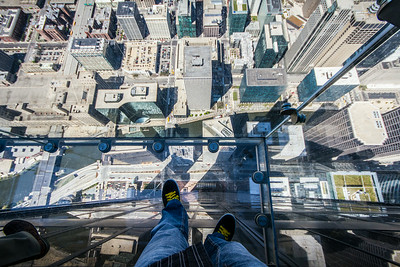 """Même pas peur!"" (""Not even scared!"")… hum hum… :-s Yeah… Right! For some people (like me…) it requires a lot of self-convincing before taking a step on the Willis Tower (formerly ""Sears' Tower"") ledges in Chicago. I'm not sure I really enjoyed the ""view on Chicago"" at that time… other pictures can prove that… but I won't show you ;-)"