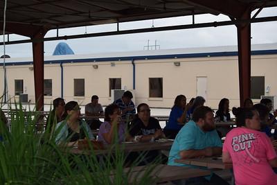 Staff Enjoying Island Music and Breakfast