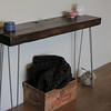 This is a table I built from another railroad tie I had, not too different from the one being used for the bench.  I got the legs from haripinlegs.com.  No stain here, just some lacquer.