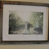 This is a framed photo of my wife and I from our wedding.  The wood is made from the stakes that are used to prop up young grapevines.  We got married at a private vineyard, so that is why we used vineyard stalks to build it.
