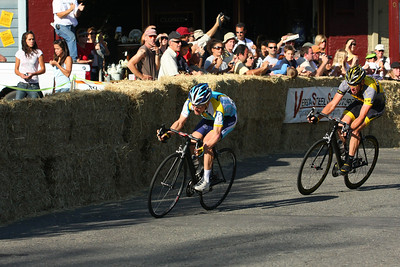 Levi Leipheimer leads Lance Armstrong into a turn.  The two biking legends exchanged the lead many times.