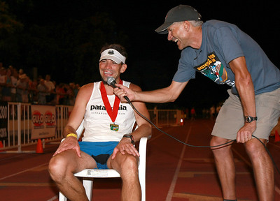 2009 WS100 winner Hal Koerner is interviewed by Tim Tweitmeyer at the finish line.  Koerner finished in 16:24:55.
