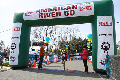 Vajin Armstrong of New Zealand crosses the finish line first at this year's 2012 American River 50 Mile Endurance Run.