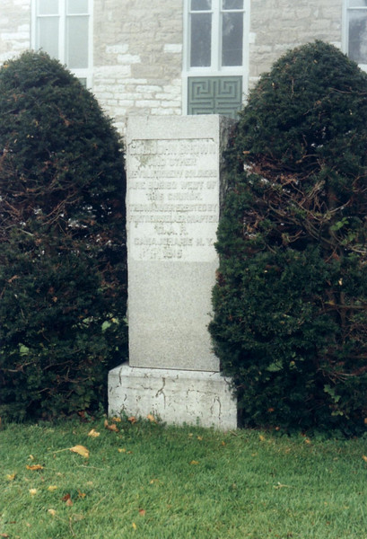 "Marker next to the church. The inscription reads: ""Colonel John Brown and other Revolutionary Soldiers are buried west of this church. This marker erected by Fort Rensselaer Chapter D.A.R. Canajoharie, NY 1915"