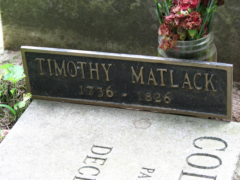 Bronze plaque on the right side of the modern stone