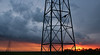 Hydro tower silhouette at sunset near Elie MB