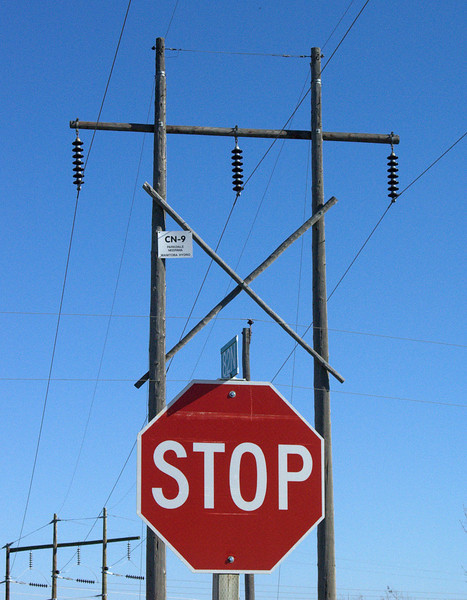 Power transmission lines and stop sign