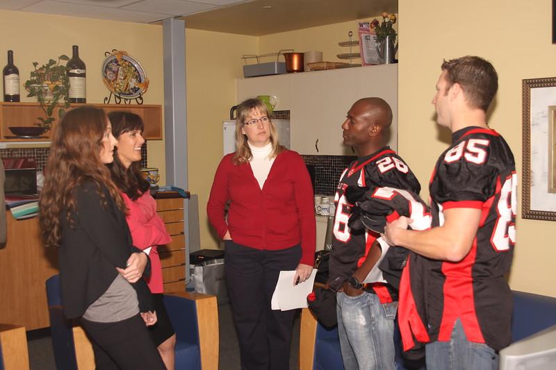 "Rachel Wiley (Oliveprsolutions.com), Nancy Mecurio (Susan G Komen, San Diego), Donna Walton (San Diego Enforcers) Damon Foreman and Jonathan Wiese in the ""Green Room."""